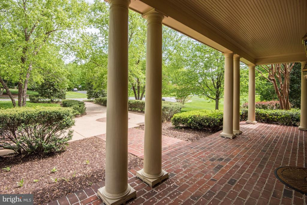 Front porch area with its southern charm. - 6412 NOBLE ROCK CT, CLIFTON
