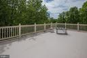 Walk out to rooftop patio with view of mountains. - 6412 NOBLE ROCK CT, CLIFTON