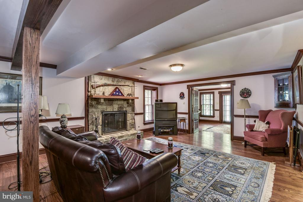 Lower level entertainment area with gas fireplace - 6412 NOBLE ROCK CT, CLIFTON