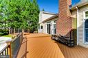 Expansive Composite Deck Leading to Pool - 7904 STARBURST DR, BALTIMORE