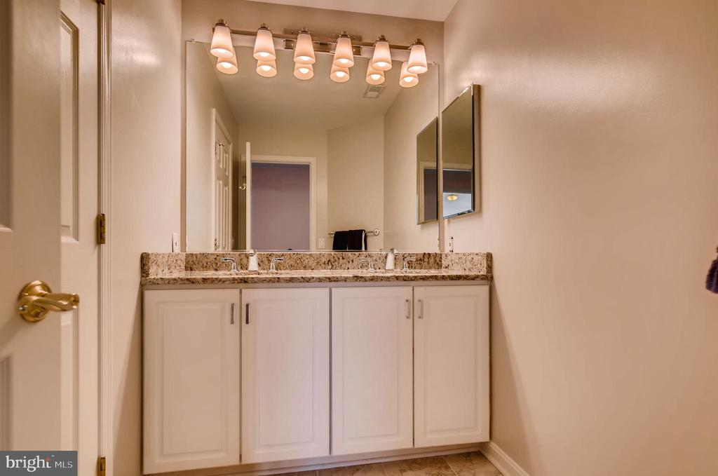 Upper Level Bathroom with Dual Vanity - 7904 STARBURST DR, BALTIMORE