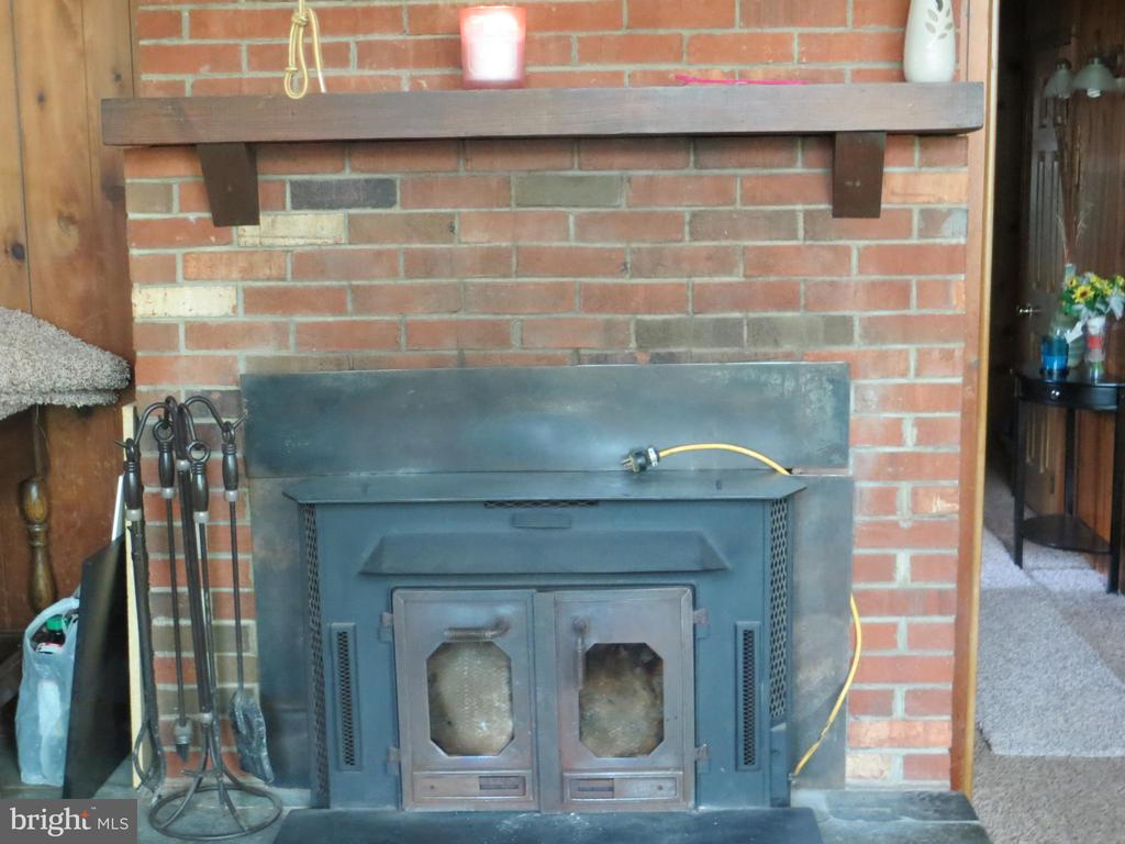 wood stove insert into masonry fireplace - 537 MT PLEASANT DR, LOCUST GROVE