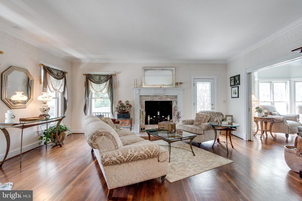 Living Room with Gas Fireplace & Cherry Flooring. - 10114 LAWYERS RD, VIENNA