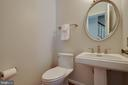 Half bath has a cute pedestal sink and mirror - 7704 LAKELOFT CT, FAIRFAX STATION