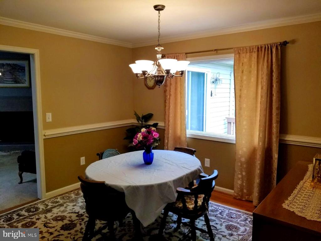 Seperate dining room with hardwood flooring - 138 EAGLE CT, LOCUST GROVE