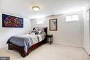 Bonus room on lower level, used as a bedroom. - 1634 MONTMORENCY DR, VIENNA