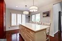 Impressive quartz-topped island with seating. - 1634 MONTMORENCY DR, VIENNA