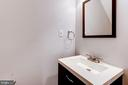 Lower level half bath. - 1634 MONTMORENCY DR, VIENNA