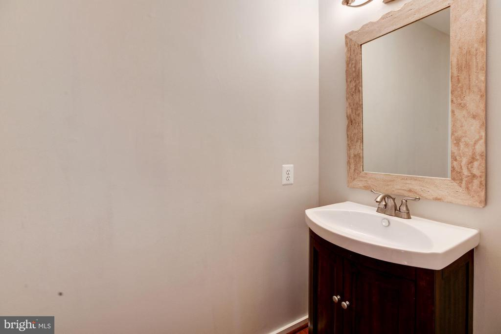 Main level half bath. - 1634 MONTMORENCY DR, VIENNA