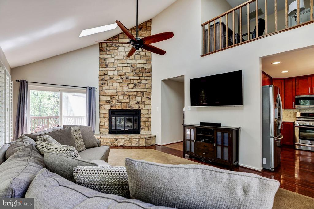 Stone fireplace, high end ceiling fan. - 1634 MONTMORENCY DR, VIENNA