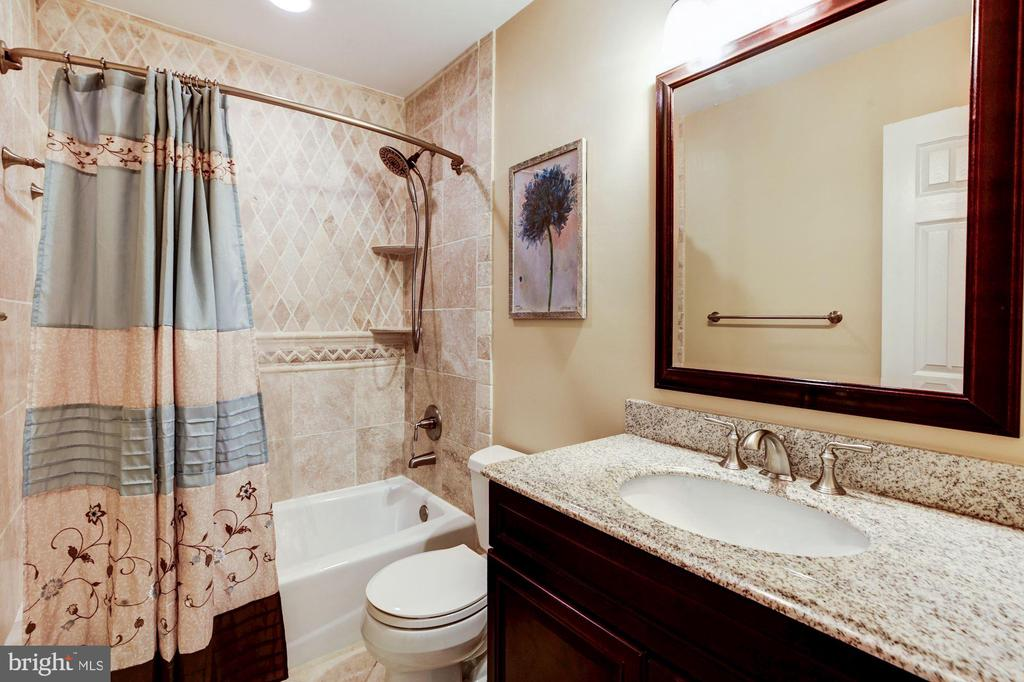 Second level main bathroom is stunning. - 1634 MONTMORENCY DR, VIENNA
