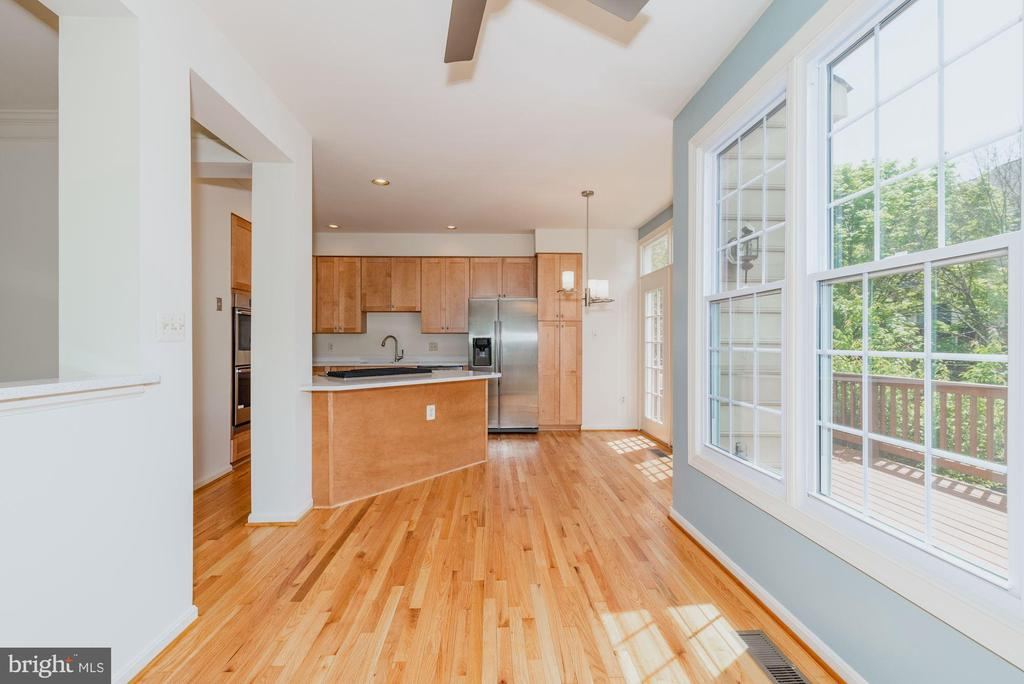 Kitchen opens to family room and deck - 2200 JOURNET DR, DUNN LORING