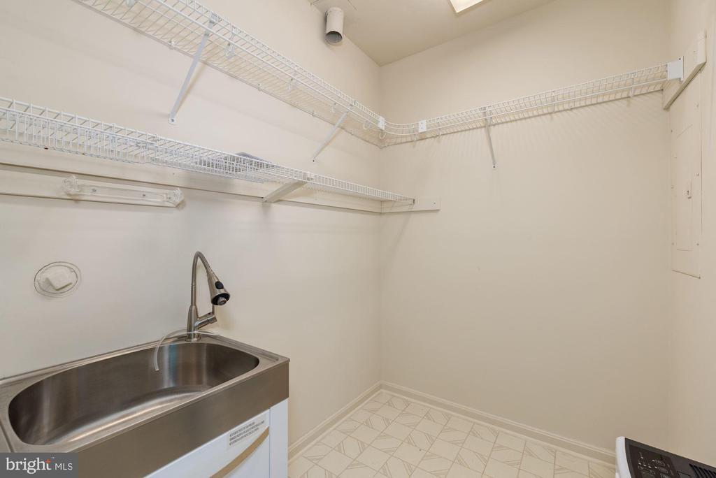 Utility sink in basement closet - 2200 JOURNET DR, DUNN LORING