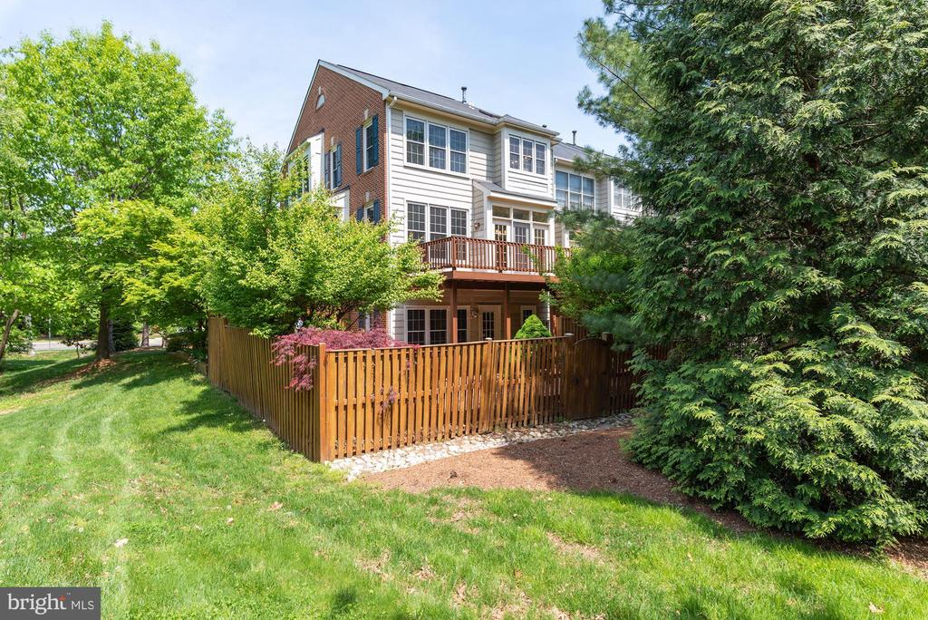 View of back surrounded by trees - 2200 JOURNET DR, DUNN LORING