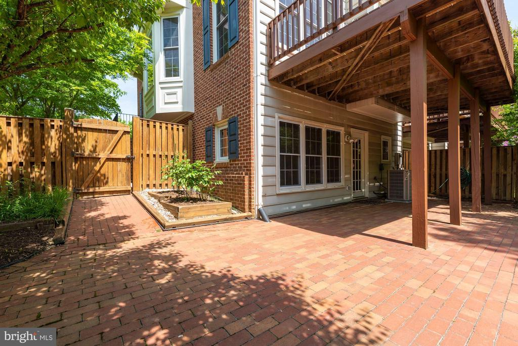 Brick patio with mature landscaping - 2200 JOURNET DR, DUNN LORING