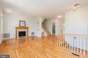 Living room hardwood floors and gas fireplace  10 - 2200 JOURNET DR, DUNN LORING