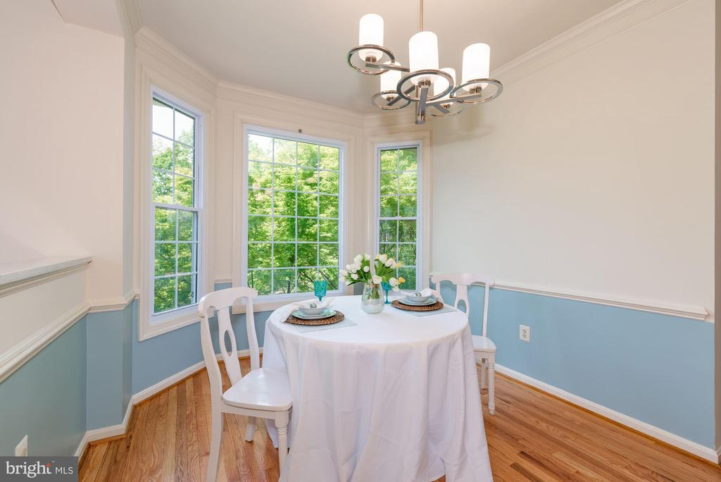 Bay window  tree view, New chandelier chair rail - 2200 JOURNET DR, DUNN LORING