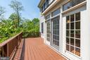 French doors  from kitchen  lead out to  deck - 2200 JOURNET DR, DUNN LORING