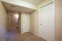 Basement hallway with laundry and storage access - 8145 MORNING BREEZE DR, ELKRIDGE
