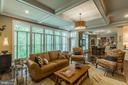 Trees are the art on your wall in this Family Room - 1207 ROSS DR SW, VIENNA