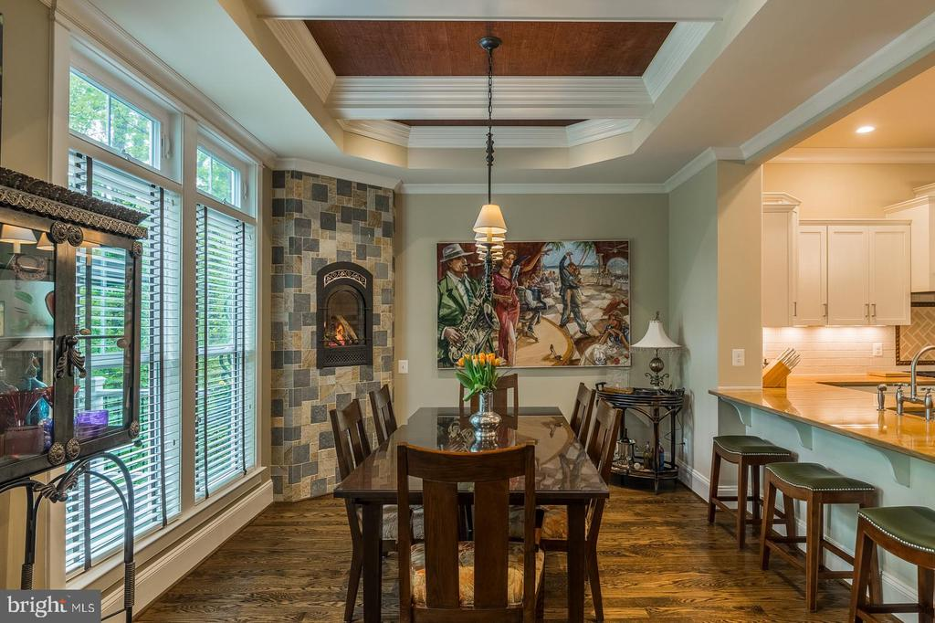 Warm, cozy dining area with gas fireplace - 1207 ROSS DR SW, VIENNA