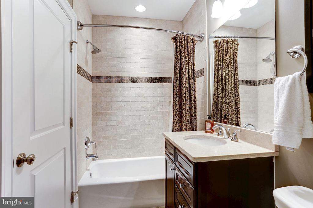 Lower Level Bath with travertine tile - 405 N HIGHLAND ST, ARLINGTON