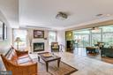 Family Room with Fireplace  & Sunroom - 6106 SEBRING DR, COLUMBIA
