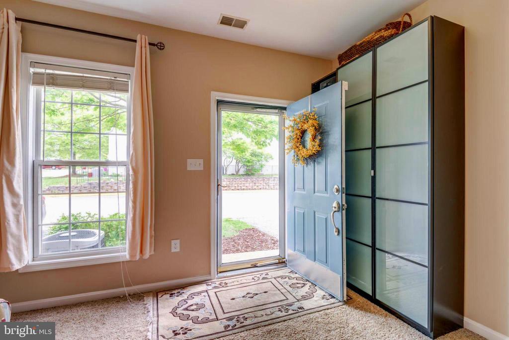 Enter the Main Level Family Room w/ Extra Closet - 2582 LOGAN WOOD DR, HERNDON