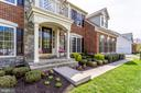 Brick/Stone exterior welcomes you home - 25647 S VILLAGE DR, CHANTILLY