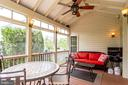 Tranquil and serene screened in porch - 25647 S VILLAGE DR, CHANTILLY