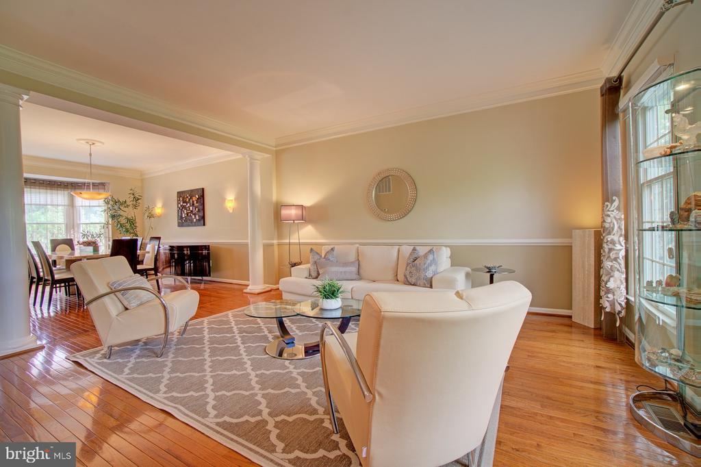 Spacious Living Room with gorgeous hardwood floors - 10753 BLAZE DR, RESTON