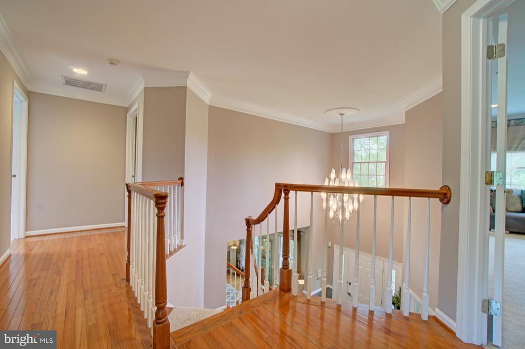 Hardwood floors on landing and BOTH staircases. - 10753 BLAZE DR, RESTON