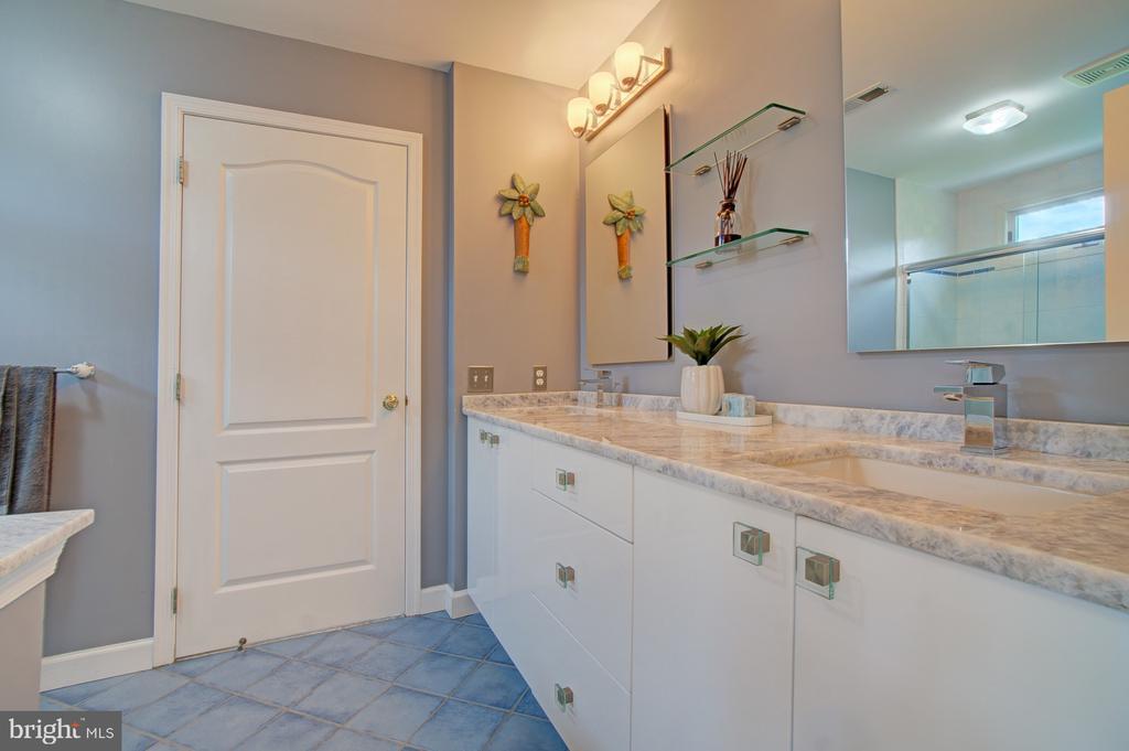 Tastefully renovated Jack and Jill Bathroom. - 10753 BLAZE DR, RESTON