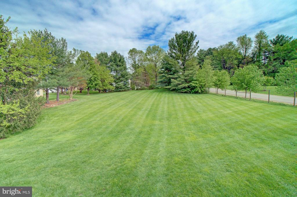 Rare opportunity to own this .93 acre level lot. - 10753 BLAZE DR, RESTON