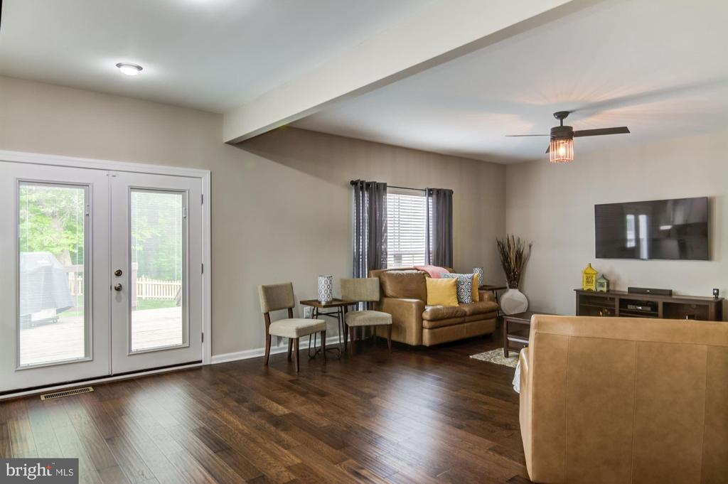 New french doors open to freshly stained deck - 15536 BOAR RUN CT, MANASSAS