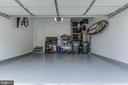 Garage with custom storage, epoxy floors - 15536 BOAR RUN CT, MANASSAS