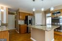 Kitchen has Granite and SS Appliances - 9310 E CARONDELET DR, MANASSAS PARK