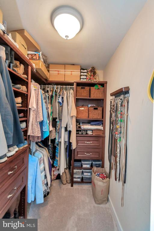 Master bedrrom Closet with Built-in - 8711 LAROQUE RUN DR, FREDERICKSBURG