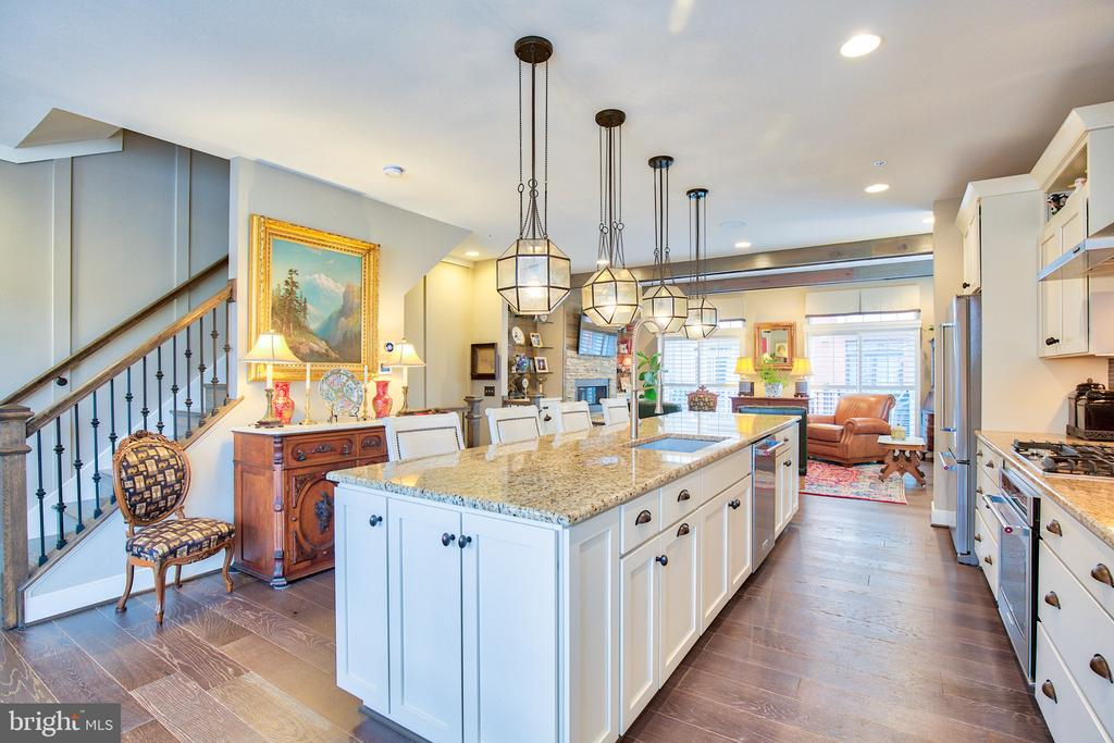 Custom lighting, hardwood flooring and island - 235 CRESCENT STATION TER SE, LEESBURG