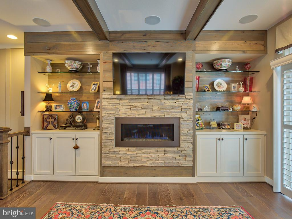 Stunning stone fireplace and built-in book cases - 235 CRESCENT STATION TER SE, LEESBURG