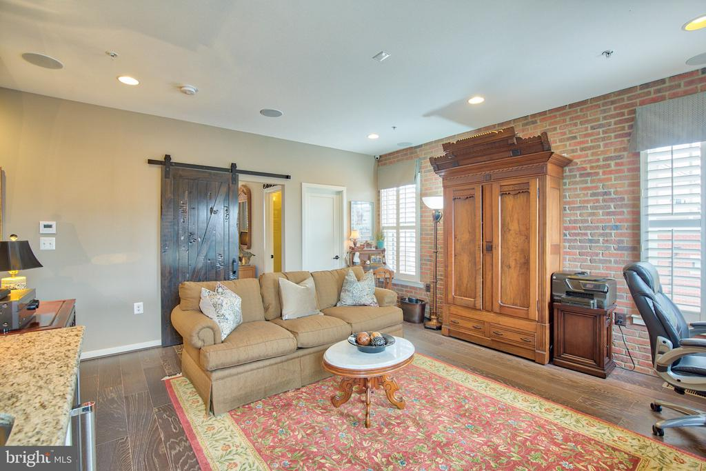 4th Level loft with barn door and exposed brick wo - 235 CRESCENT STATION TER SE, LEESBURG