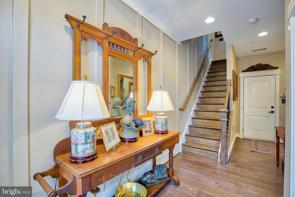 Foyer with custom oak stairs, & 7