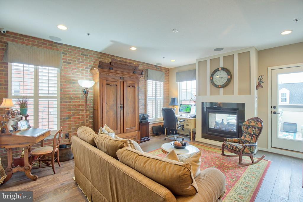 4th level loft with double sided fireplace - 235 CRESCENT STATION TER SE, LEESBURG