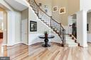 Custom Ballisters on Curved Staircase - 19060 AMUR CT, LEESBURG
