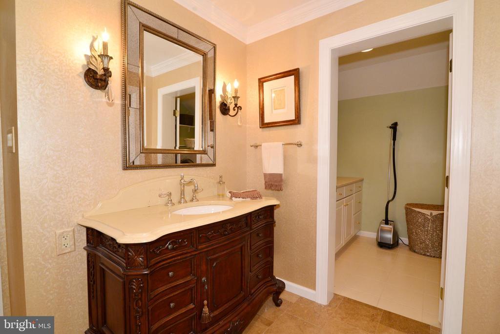 Owner's bath vanity #2, entry to laundry station. - 2403 SAGARMAL CT, DUNN LORING