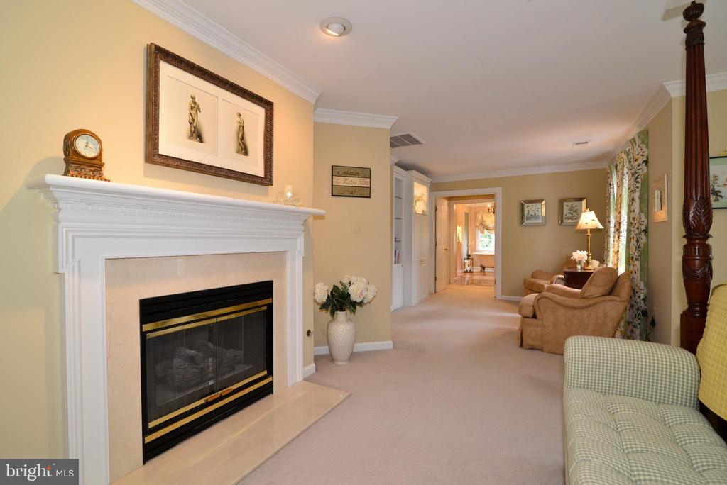 Cozy gas fireplace in owner's suite. - 2403 SAGARMAL CT, DUNN LORING