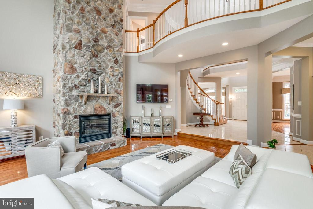 2-story Stone Gas Fireplace warms this room - 42841 SANDHURST CT, BROADLANDS