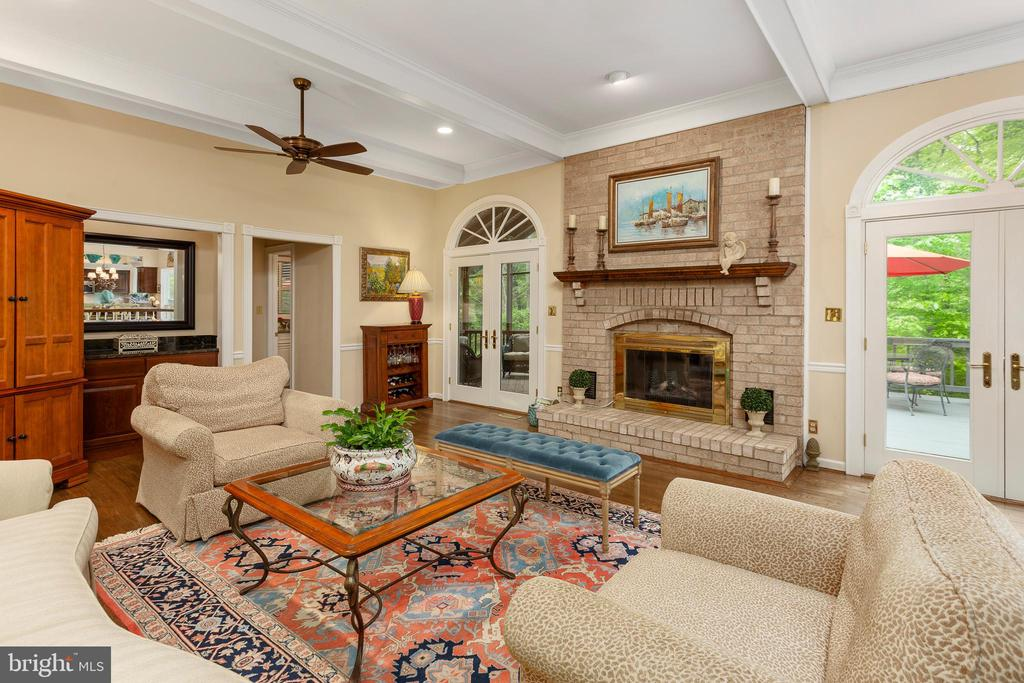 Family Room with Fireplace & Doors to Deck - 8512 CATHEDRAL FOREST DR, FAIRFAX STATION