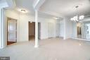 View of MBR entry hall on left, Library Next - 440 BELMONT BAY DR #401, WOODBRIDGE