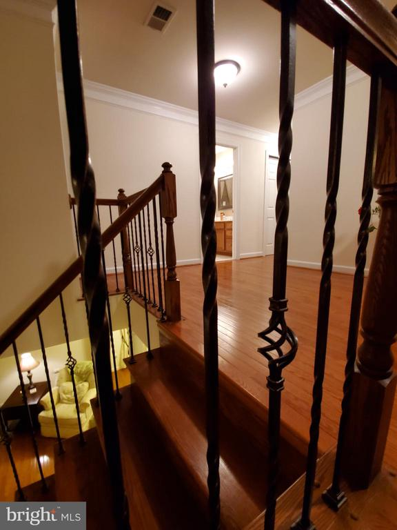 Upgraded wrought iron railing on stairs. - 4152 AGENCY LOOP, TRIANGLE